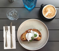Poached eggs on toast with coffee