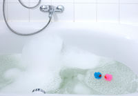 Pink and blue duck in a bathtub