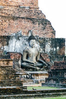 statue of the buddha in wat arun temple of ayutthaya thailand, digital photo picture as a background