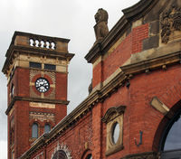 a close up view of the entrance and clock tower to the market hall in ashton under lyne built in 1829