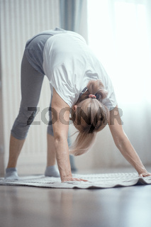 Attractive woman does downward facing dog pose