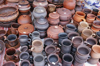 Traditional Ukrainian homemade clay kitchen plates and pots in lithuania