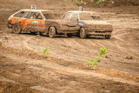 Traditional rally .The racing car drives into a steep turn, scattering, spraying dirt, dust. Extreme rally, autocross