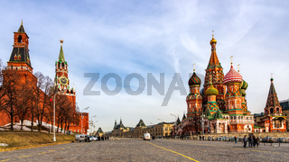 Tourists visiting St Basils Cathedral, Beautiful Spasskaya Tower and The Tsars Tower on the Red Square
