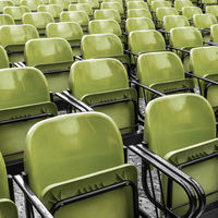 Empty plastic green chairs