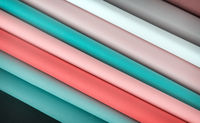 Folded sheets of paper in different colors.