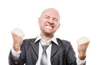 Smiling businessman winner gesturing raised hands fist celebrating victory achievement
