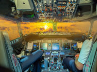 Airbus airplane cockpit Flight Deck in sunset
