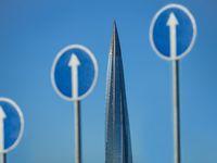 arrows up and spire skyscraper
