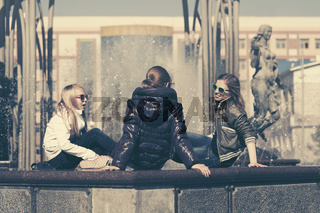 Group of happy teen girls talking in city street