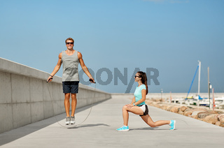 happy couple warming up on pier before training