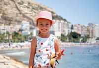 Little girl on Postiguet beach. Alicante city. Spain