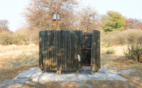 Bucket shower on a campsite in the Kalahari