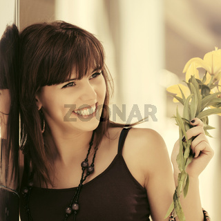 Happy young woman with flowers outdoor