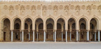 Arched corridor surrounding the courtyard of public historic Moaayad mosque, Cairo, Egypt
