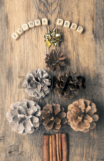 German Merry Christmas with pine cones
