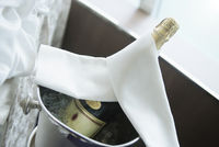 Champagne Bottle In A Bucket Of Ice. Concept for Wedding Or Anniversary Celebration