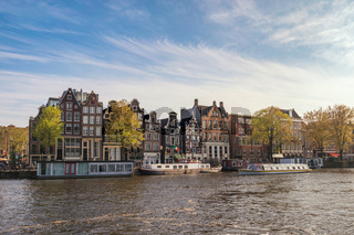 Amsterdam Netherlands, city skyline Dutch house at canal waterfront
