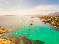 Yachts in the cove of turquoise sea. Aerial drone view of incredible landscape. Xinxell, Playa de Illetas, Palma de Mallorca, Balearic Islands. Popular tourist destinations