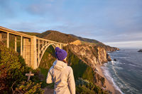 Woman tourist near Bixby Creek Bridge in California