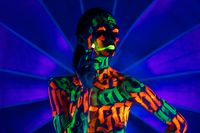 Girl with UV bodyart waisteup shot