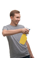 Happy man with water sprayer isolated portrait