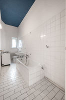 old white tiled bathroom with bathtub - renovation concept