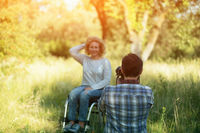 Professianl photographer takes photo of woman in wheelchair