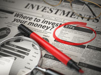 ETF is a best option to invest. Where to Invest concept, Investmets newspaper with loupe and marker.