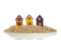 Colorful handmade beach cabins on island