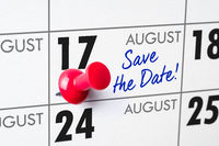 Wall calendar with a red pin - August 17