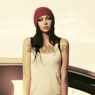 Young fashion hipster woman in white tank top standing beside her car