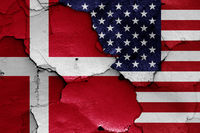 flags of Denmark and USA painted on cracked wall
