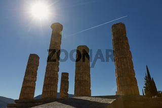 Low Angle View of The Temple of Apollo at Delphi, Greece with Sun Star Effect.