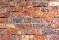 Rote raue Backsteinwand