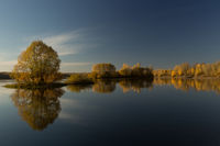 Soft autumn landscape, reflected in calm water