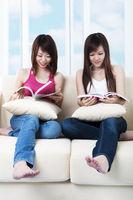 Asian females reading book