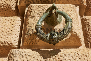 Decoration ring on the wall of Palacio de Carlos V in La Alhambra, Granada, Spain