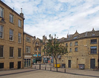 old buildings and shops in oastler square in bradford west yorkshire