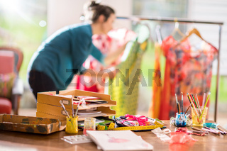 Fashion designer working on a new model, in her studio
