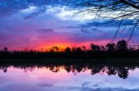 Dramatic Sunset over Lake Beautiful Water Reflection in Wilderness Forest Outdoors Afternoon