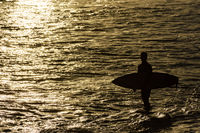 Surfer silhouette at sunset