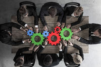 Business people with cogs of business