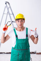 Young worker with protective equipment in safety concept