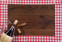 Red and white checked table runners forming a frame with a Basket bottle of Chianti Wine