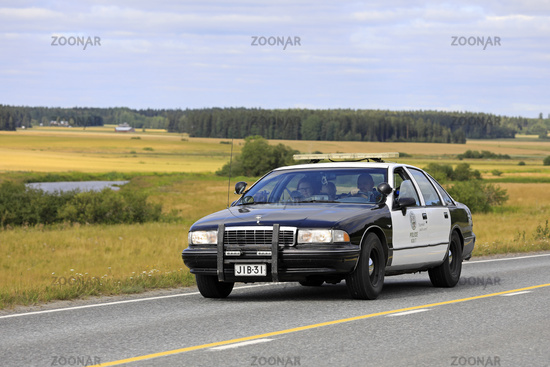 Chevrolet Police Car on Road