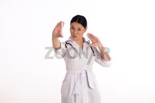 Nurse holding up pill bottles.