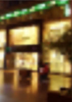 Blurred Night Street with Lighting Shop Windows