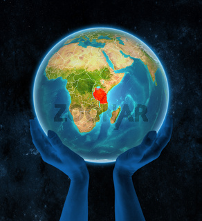 Tanzania on Earth in hands in space