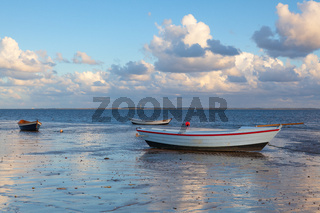Fishing boats on the empty beach, Hjerting, Jutland, Denmark.